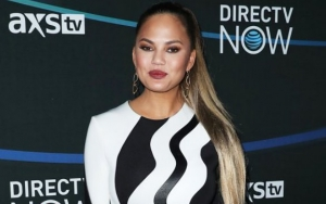 Chrissy Teigen Hits Back at Troll Over Her Family Vacation in Bali