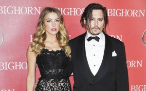 Amber Heard on Johnny Depp's $50M Defamation Suit: He's 'Hell-Bent on Achieving Self-Destruction'