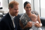 Smiling Prince Harry Arrives in Canada to Reunite With Meghan Markle and Baby Archie