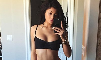 Kylie Jenner Shows Off Her Curves in Black Bikini Before 'Swim Session' With Kourtney Kardashian