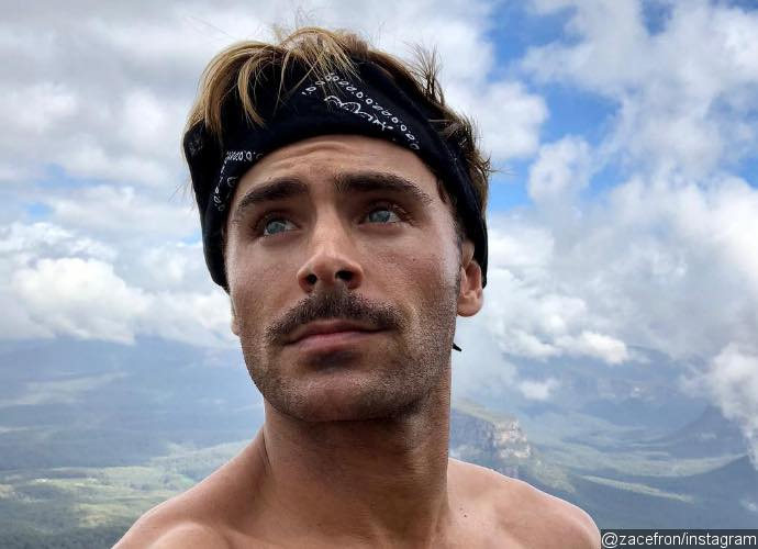 Zac Efron Spends Christmas by Hiking Shirtless