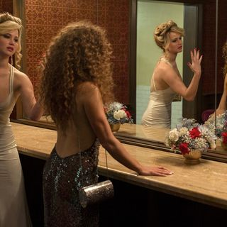 Jennifer Lawrence stars as Rosalyn Rosenfeld and Amy Adams stars as Sydney Prosser in Columbia Pictures' American Hustle (2013)