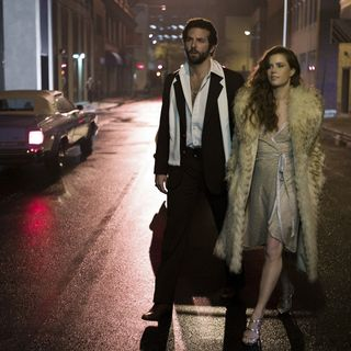 Bradley Cooper stars as Richie DiMaso and Amy Adams stars as Sydney Prosser in Columbia Pictures' American Hustle (2013)