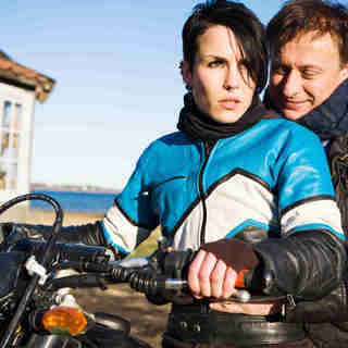 Noomi Rapace stars as Lisbeth Salander and Michael Nyqvist stars as Mikael Blomkvist in Music Box Films' The Girl with the Dragon Tattoo (2010)