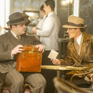 Josh Gad stars as Hector MacQueen and Johnny Depp stars as Ratchett in 20th Century Fox's Murder on the Orient Express (2017)