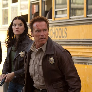 Jaimie Alexander stars as Sarah Torrance and Arnold Schwarzenegger stars as Sheriff Ray Owens in Lionsgate Films' The Last Stand (2013)