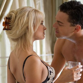 Margot Robbie stars as Naomi Lapaglia and Leonardo DiCaprio stars as Jordan Belfort in Paramount Pictures' The Wolf of Wall Street (2013)