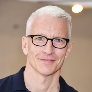Anderson Cooper Signs Copies of His Book The Rainbow Comes and Goes