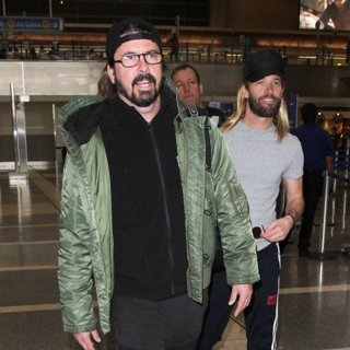 Dave Grohl, Taylor Hawkins, Foo Fighters in Dave Grohl and Taylor Hawkins Arrive at Los Angeles International Airport