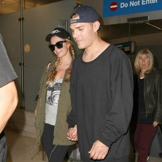 Paris Hilton Arrives at Los Angeles International Airport with Chris Zylka