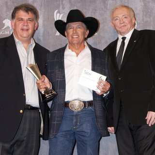 Bob Romeo, George Strait, Jerry Jones in 49th Annual Academy of Country Music Awards - Press Room