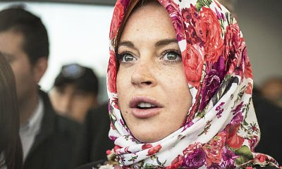 Lindsay Lohan Claims She Was 'Racially Profiled' for Wearing Headscarf at Airport