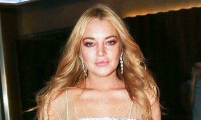 Lindsay Lohan Steps Outs Sans Hijab as She Parties With a Mystery Man in Greece