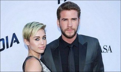 Did Miley Cyrus Elope With Liam Hemsworth? Dad Shares Pic of Her in White Dress