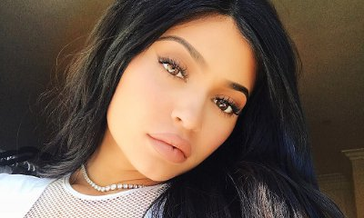 Kylie Jenner Flaunts Ample Cleavage in Plunging Mesh Top in New Selfie