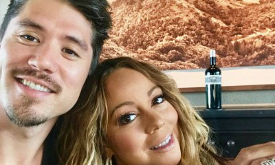 Mariah Carey Flaunts Ample Cleavage as She Cuddles Up to Bryan Tanaka