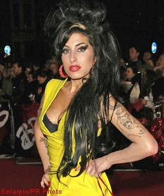 Amy Winehouse's Incarcerated Husband Begs Her Not to Leave Him