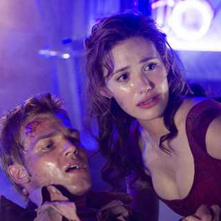 MIKE VOGEL as Christian and EMMY ROSSUM as Jennifer Ramsey in Warner Bros Pictures' Poseidon (2006)